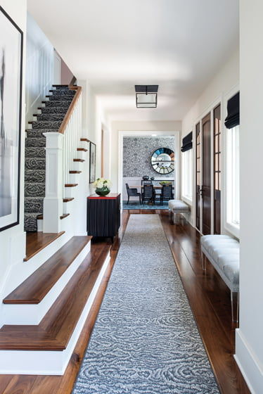 A stair in the entry corridor leads to the second floor's three guest rooms.