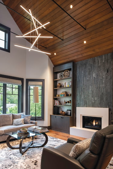 The master suite's library features a dramatic pendant by Sonneman.