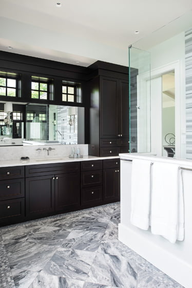 Meyers incorporated the master bath's clerestory windows into the cabinetry.