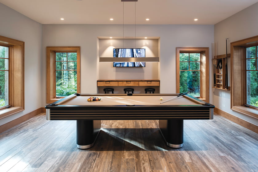 Deep window sills allow for seating around the pool table from Premium Spa & Billiards.