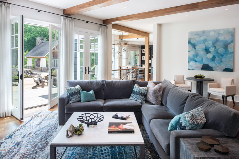 A sectional by A. Rudin frames a custom coffee table by Salvations in the family room.