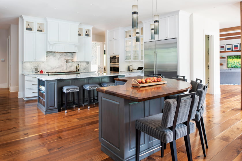 The kitchen features an island for food prep and another for casual meals or entertaining.