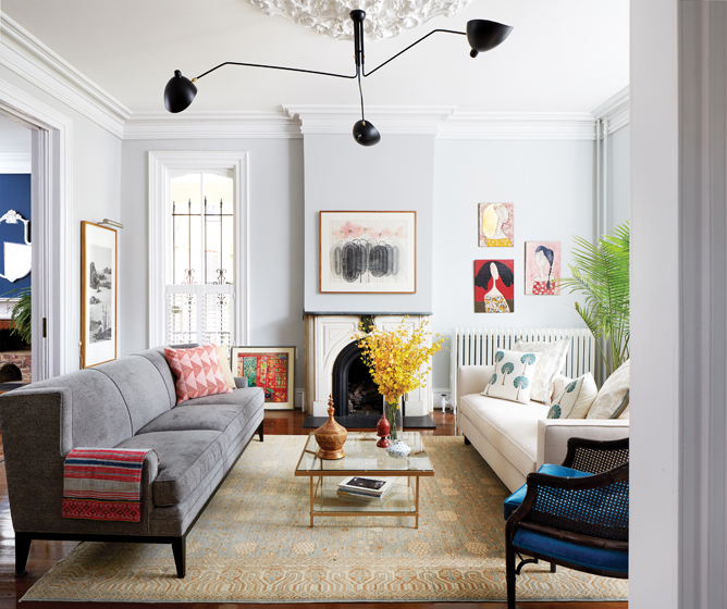 Eclectic furniture and art lend personality to the parlor.