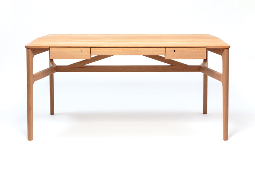 Intricate joinery, a trestle base and locking drawers distinguish the Taper Desk.