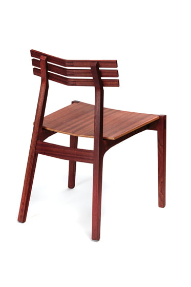 The Ladder Back Chair, shown in sapele, has an angled back.