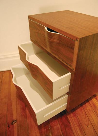 The Rippled Dresser, in walnut, boasts sculpted drawer pulls.