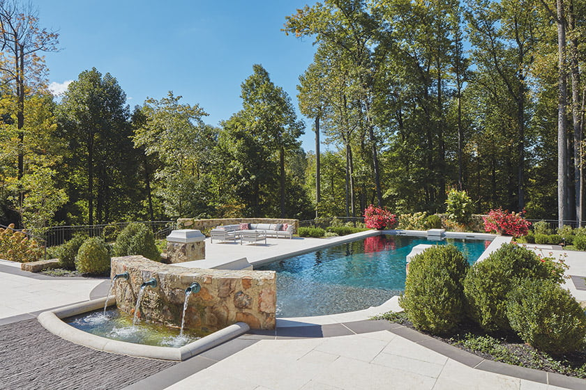 Lothorian Pools designed and installed the pool, with its limestone surround and a water feature made of over-grouted stone.