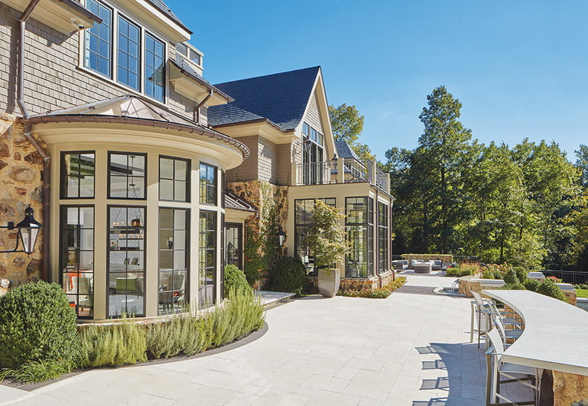 The limestone patio features an outdoor kitchen and bar area for casual meals.