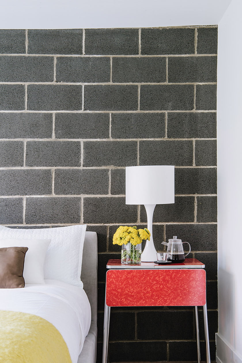 Exposed, insulated concrete blocks add interest in the bedroom.