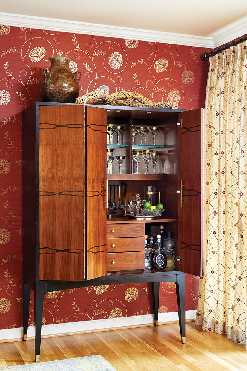The bar cabinet features plenty of storage.