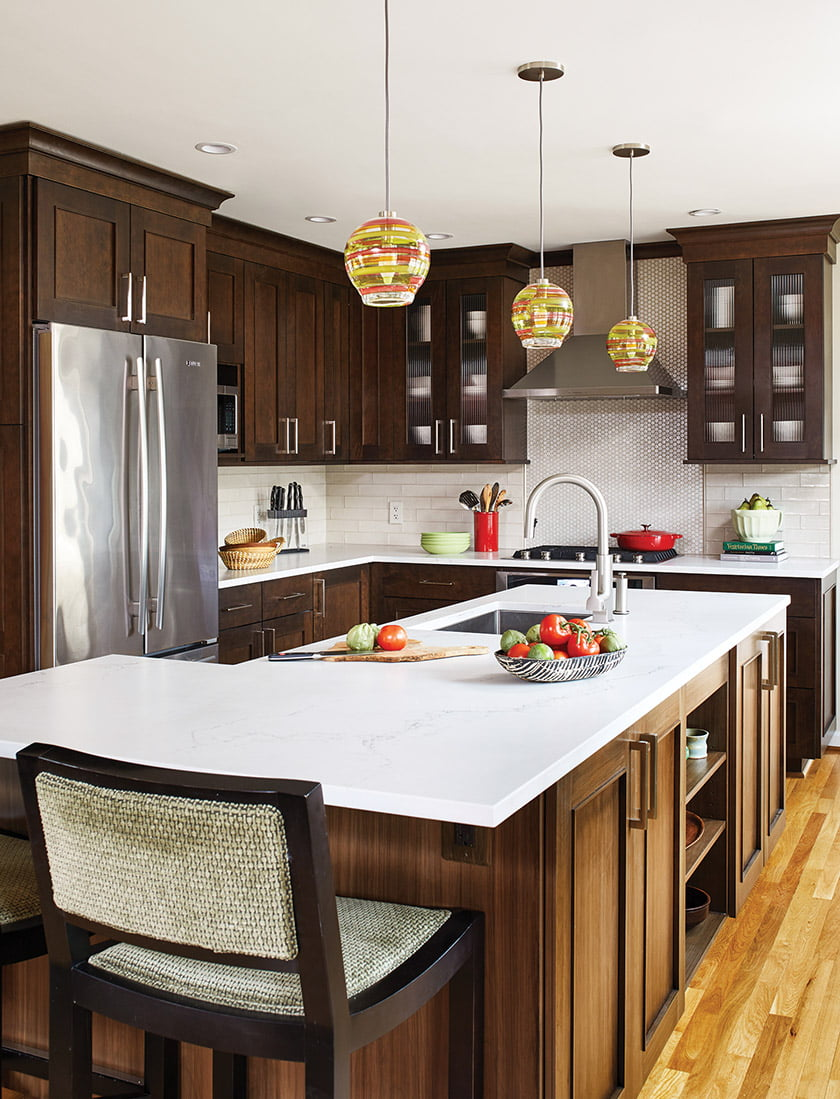 Dark-stained cherry cabinetry offsets Caesarstone counters.