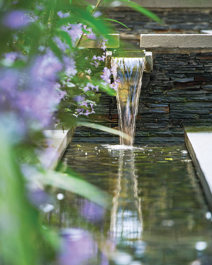 A scupper channels water from the basin into the rill.