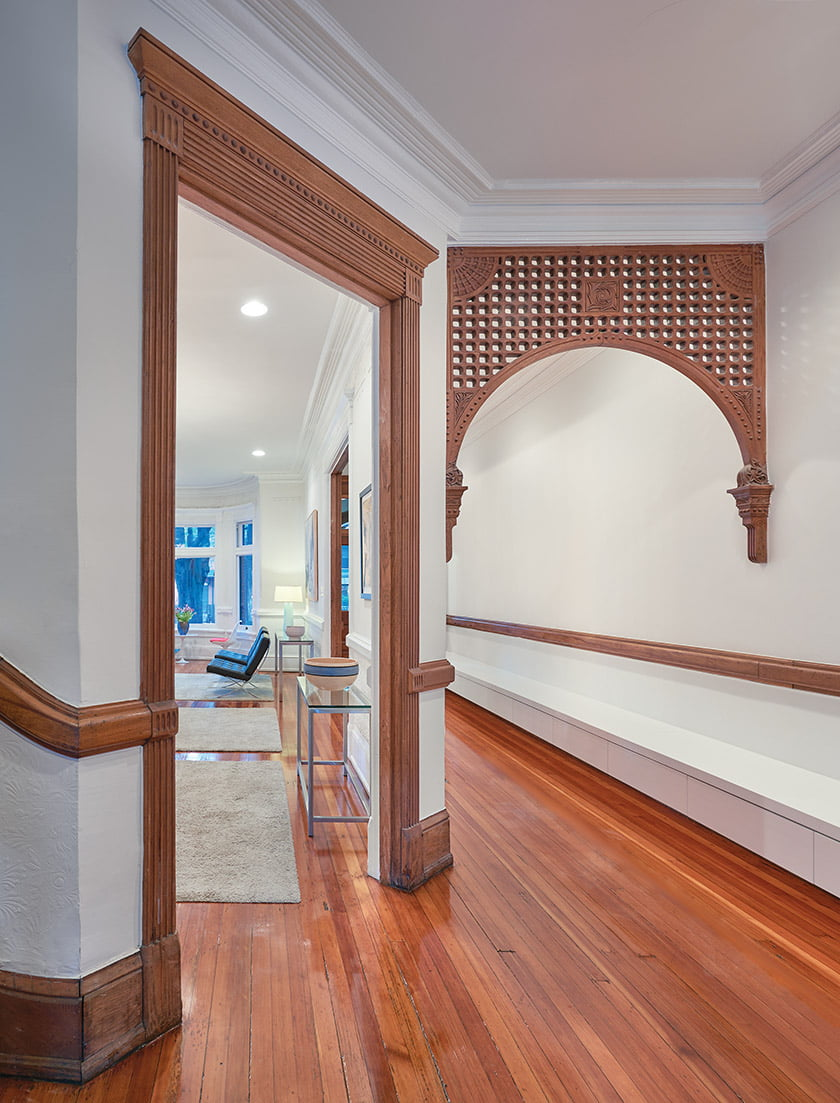 Though his mandate was to create a modern aesthetic, Dorman retained the intricate fretwork and moldings in the hall.