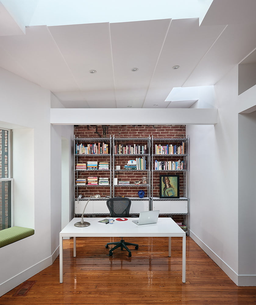 The wife's office, encompassing a sitting area, is on the same floor.