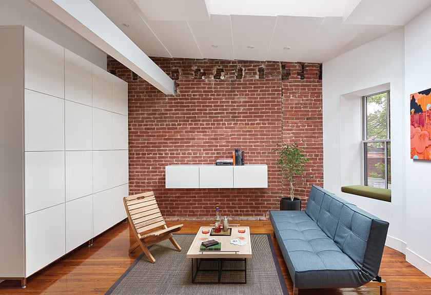Dorman exposed brick walls in the space and juxtaposed them with modern built-ins.