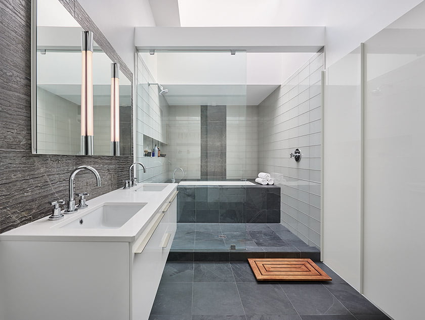 The spacious master bath is clad in stone-look porcelain tile.