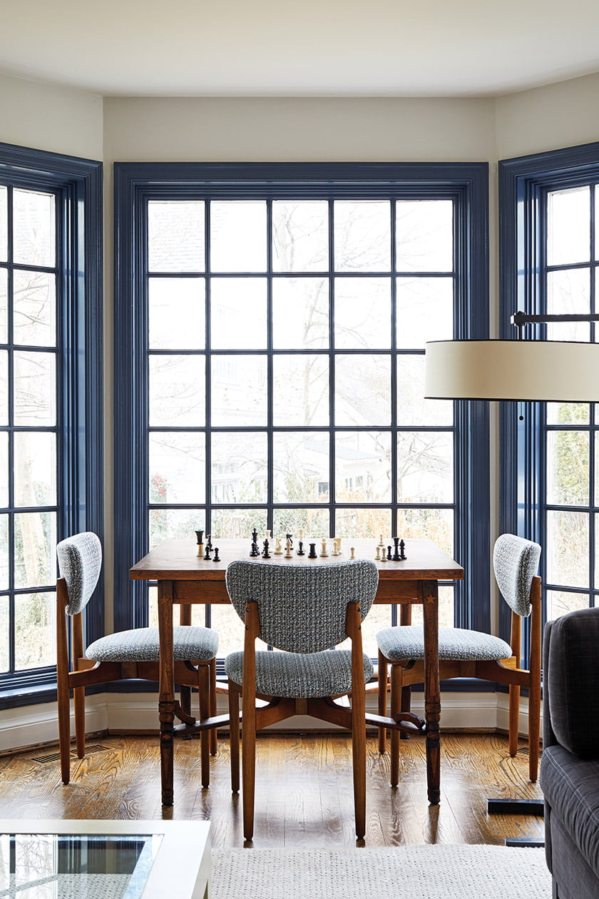 CB2 chairs gather around a game table in the family room's bay window.