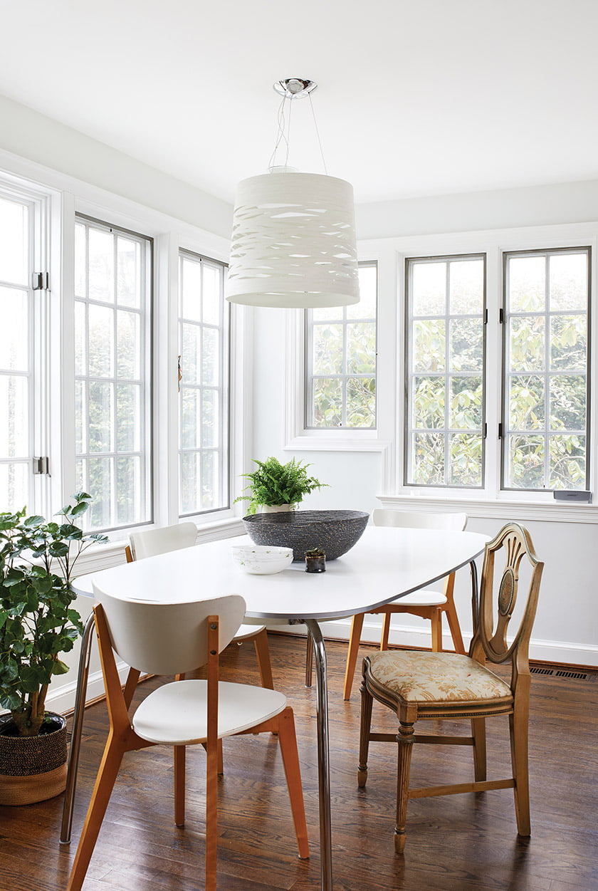 In the breakfast room, a Foscarini pendant hangs above a table and chairs from Ikea.
