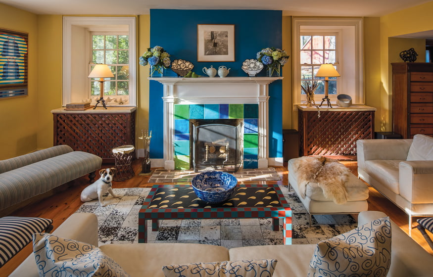 A Diane Arbus photograph hangs above a fireplace adorned with tiles by Gary Erickson.