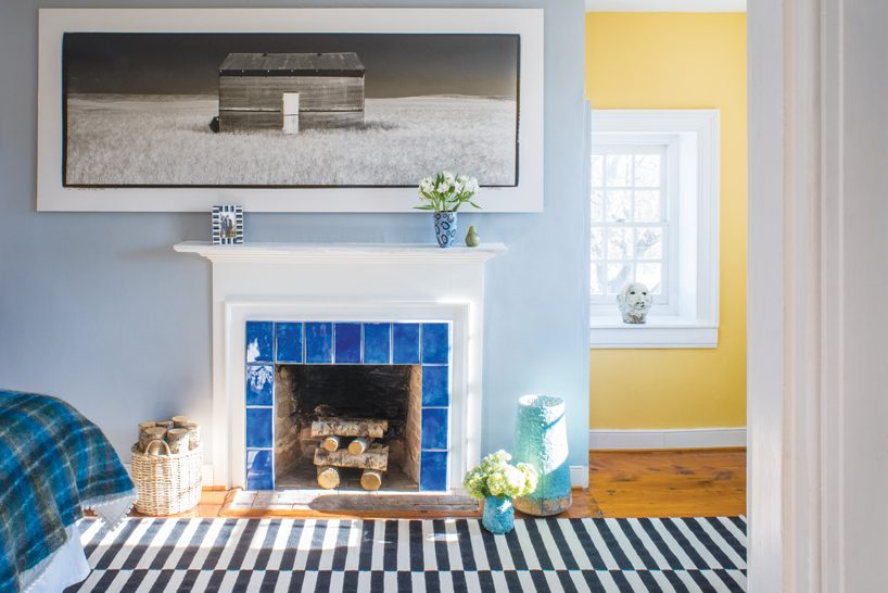 The cheerful master bedroom showcases MacKenzie's photograph of a solitary barn in Pendroy, Montana.