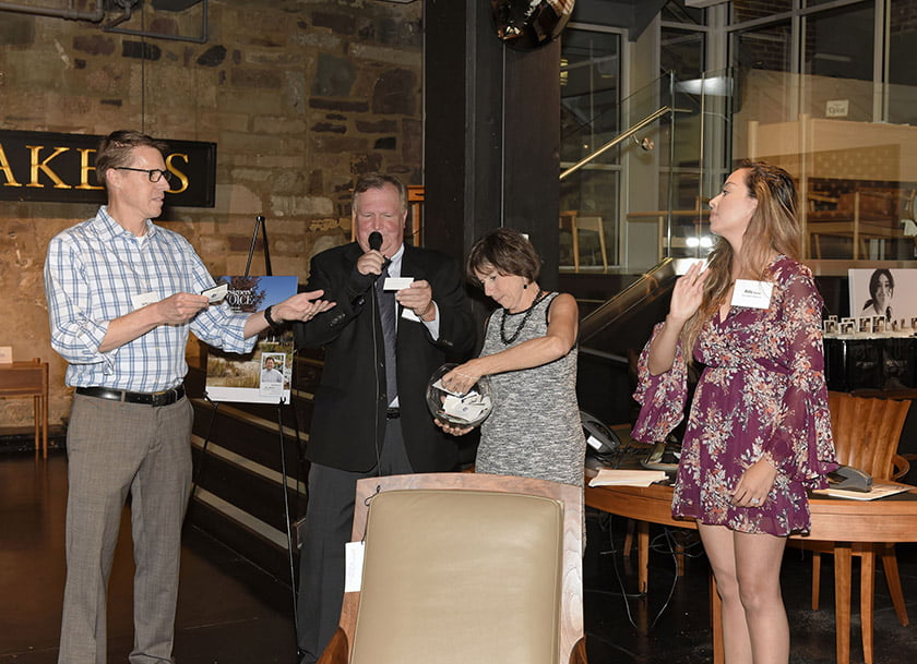 Door-prize drawing, left to right: Home & Design's Jerry Parks, publisher Tod Herbers, Idea Book editor Julie Sanders, Aida Gaddy.