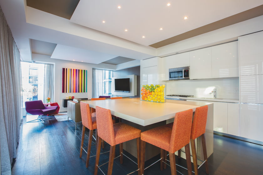 The reconfigured apartment features a new kitchen island of Santalla's design.