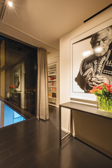 A portrait of actor Ian McKellen by photographer Steve Pyke makes a bold statement in the entryway.
