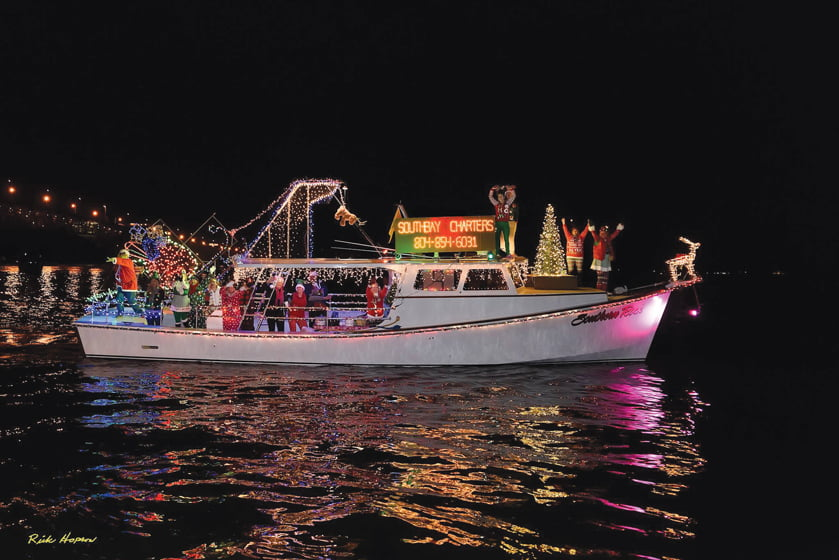A South Bay Charters yacht, decked out for the annual Lighted Boat Parade.