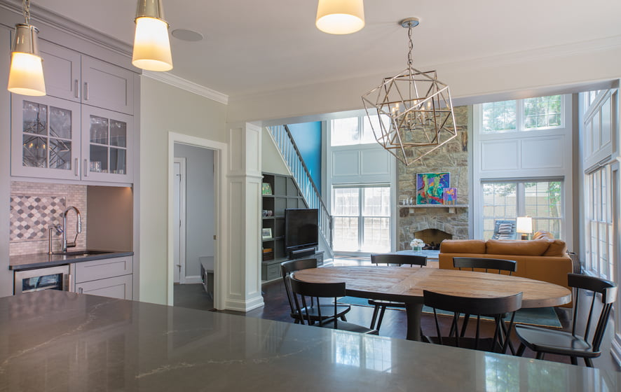 The family room now boasts built-ins beneath the staircase.