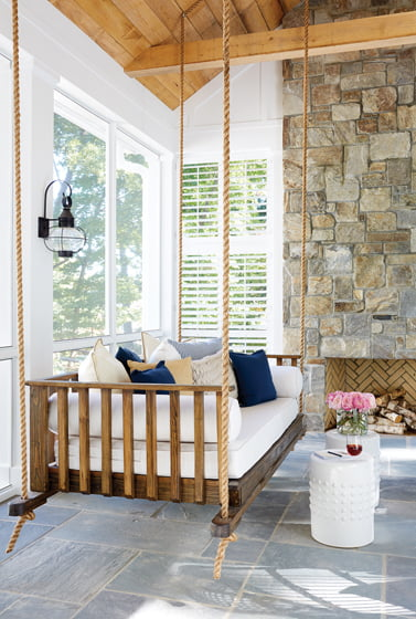 The screened porch features a custom swing from Original Charleston Bedswing Co.
