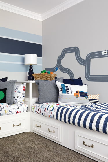 In another kids' room, the designer installed racetrack and racing-stripe wall decals.