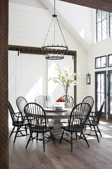 Sliding, barn-style doors link the casual dining area to the playroom and homework station.