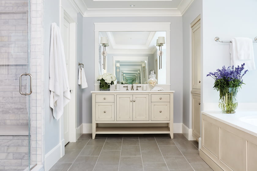 The master bathroom offers a soaking tub and durable Silestone countertops.