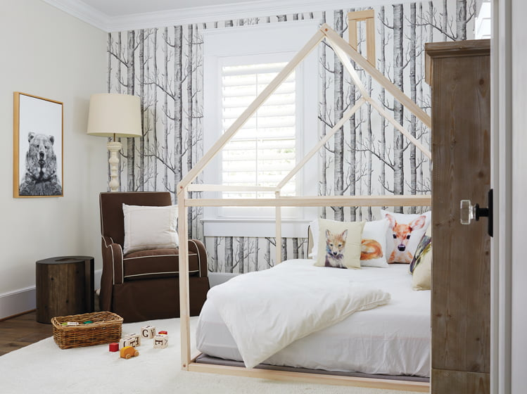 Woods wallpaper by Cole & Son served as the inspiration for a son's wilderness room.