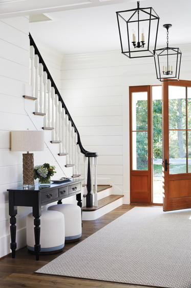 The entry, with its shiplap siding, introduces design elements that repeat throughout the house.