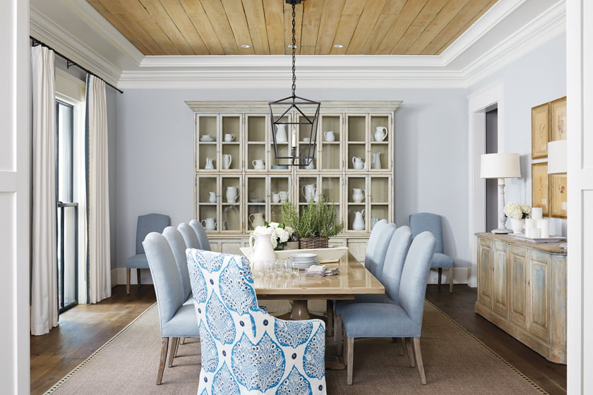 A tongue-and-groove cypress ceiling adds rusticity to the casually elegant dining room.