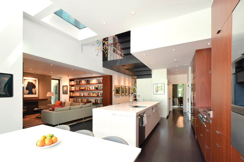 Skylights brighten the kitchen, which is three feet taller than the older rooms of the house.