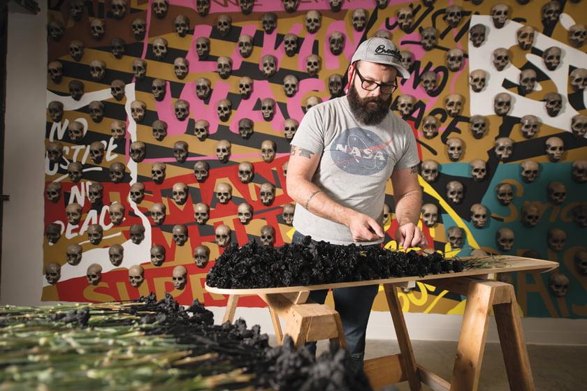 Dustin Farnsworth creates art work in wood.