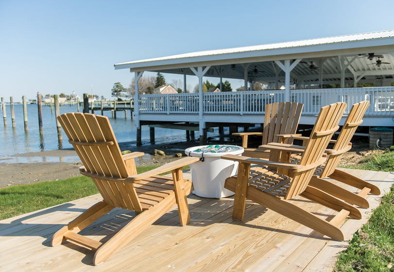 Adirondack chairs provide a waterside gathering spot for guests.