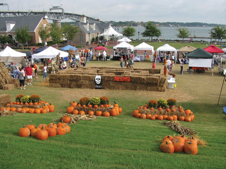Pumpkins and a maze made of hay lure visitors during Yorktown Market Days' Fall Festival in October.
