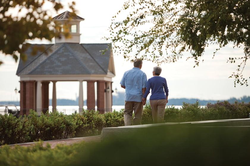 A couple strolls along Riverwalk Landing.
