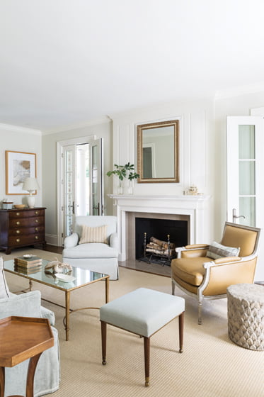 The living room features a skirted chair by Hickory Chair and a Louis J. Solomon bergère.