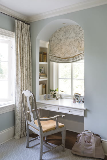 A desk created in a window niche in the master bedroom is paired with an antique Gustavian chair.