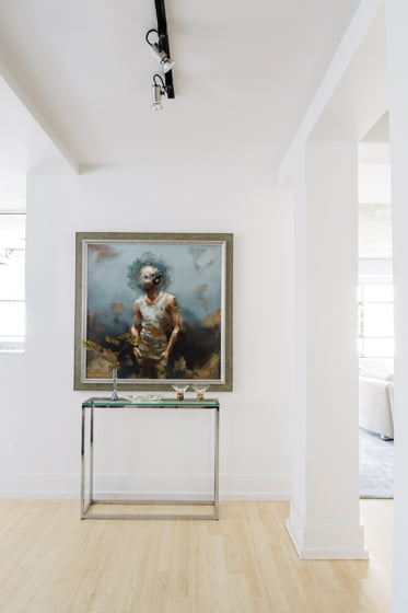 A prized painting by Danish artist Niels Corfitzen greets visitors from a wall facing the front door.
