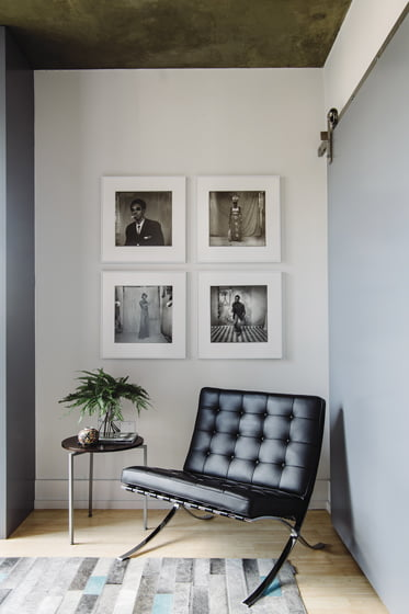 The music room features a Knoll Barcelona chair, a hair-on-hide rug and gelatin silver prints by Sory Sanlé.