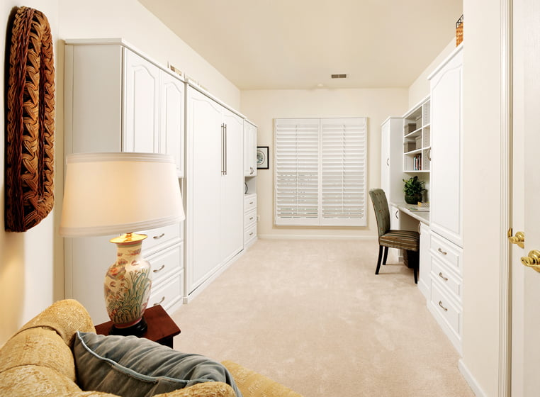 The same space with the Murphy bed tucked into a wall of cabinetry. © Bob Narod