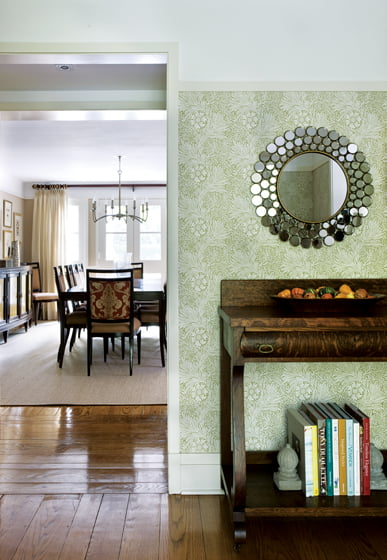 William Morris botanical wallpaper in the entry inspired Meyer's color scheme and focus on nature.