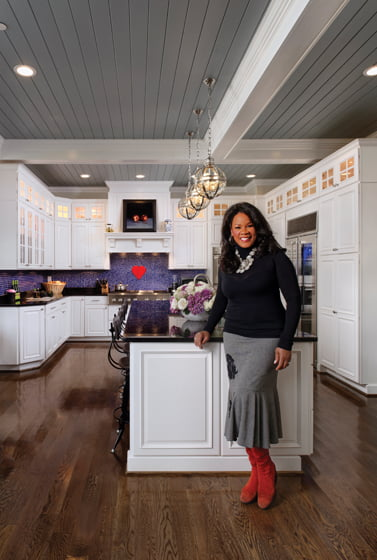 Denyce Graves loves to cook in the cheery space, where friends and family can easily gather.
