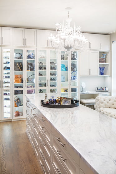 A marble-topped island in a closet by More Space Place. © Robert Meyers