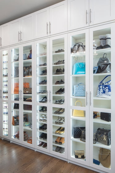 Shoes and handbags on display in the closet by More Space Place. © Robert Meyers